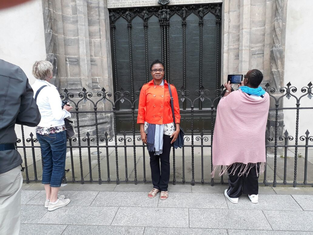 "At the door of the castle church in Wittenberg, where (aus the legend says) Martin Luther ""posted"" the 95 themes."
